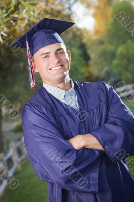 Handsome Male Graduate in Cap and Gown