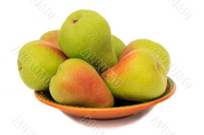 Ripe pears on the plate on a white background.