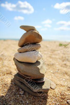 The Balanced Design of Seashore Stones
