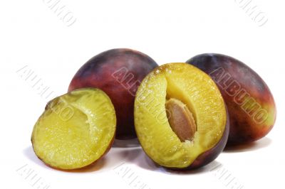 Large ripe plums on a white background.