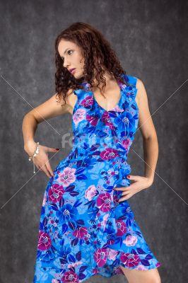 female dressed in a blue dress