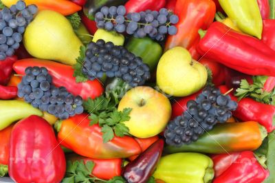 A lot of various fruits, red , yellow and green pepper.