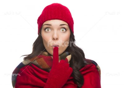 Wide Eyed Mixed Race Woman Wearing Winter Hat and Gloves