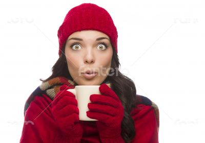 Wide Eyed Mixed Race Woman Wearing Winter Gloves Holds Mug