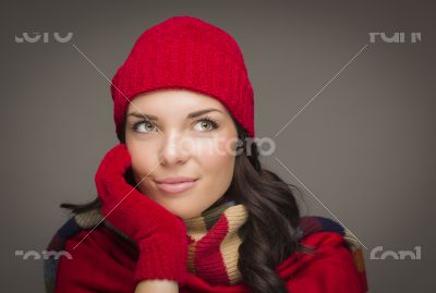Smiling Mixed Race Woman Wearing Mittens Looks to Side