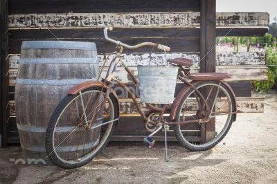 Old Rusty Antique Bicycle and Wine Barrel
