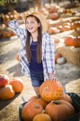 Preteen Girl Playing with a Wheelbarrow at the Pumpkin Patch