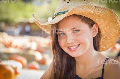 Preteen Girl Portrait Wearing Cowboy Hat at Pumpkin Patch