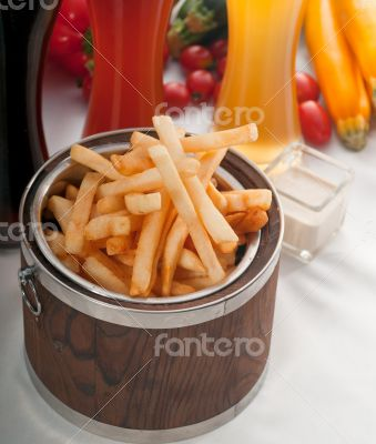 fresh french fries on a bucket