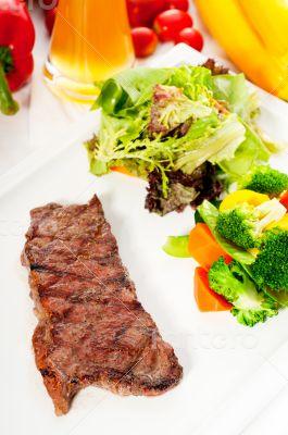 juicy BBQ grilled rib eye ,ribeye steak and vegetables