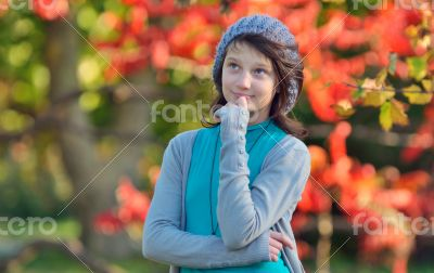 girl thinking in nature on background of autumn
