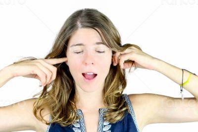 Blocking her ears