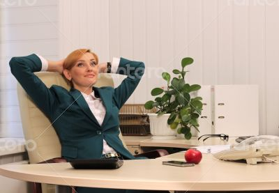 Beautiful Businesswoman in Her Study Dreaming