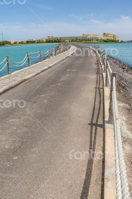 Narrow walkway along the sea