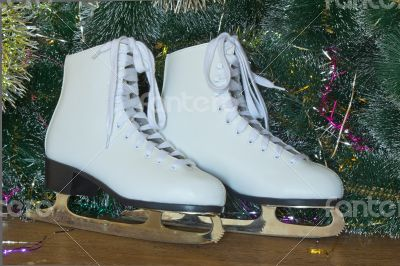 New year`s gift - the beautiful woman skates.