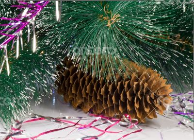 Decoration for the Christmas tree is a pine cone.