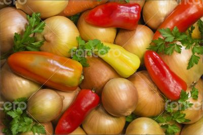 Red, yellow , green pepper, onion and parsley leaves.
