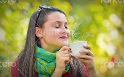 Beautiful Girl enjoy a coffee in Nature