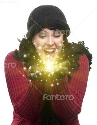 Excited Woman In Winter Clothes Holds Something Sparkling In Han