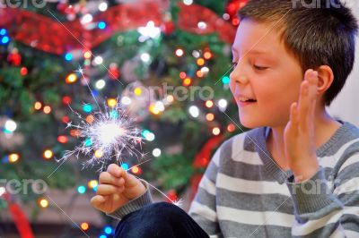 portrait of boy looking at  fire sparks