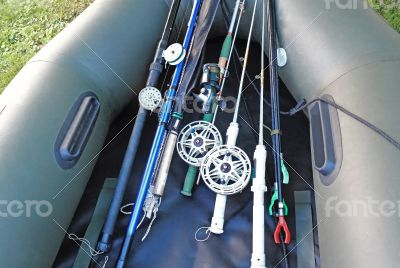 Prepared for fishing, spinning, fishing rods, rubber boat.