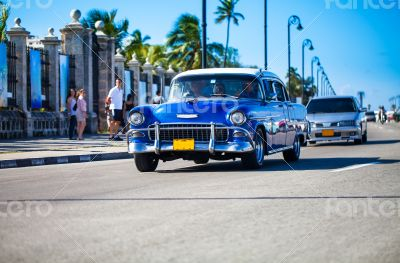Caribbean Cuba classic car traveling on the promenade in Havana