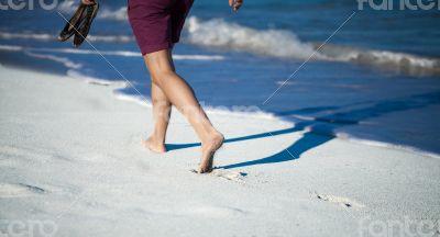 Caribbean cuba woman goes for a walk on the beach in the Caribbean
