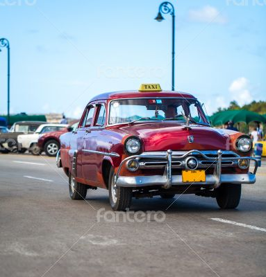 Caribbean Cuba Havana taxi on the boardwalk