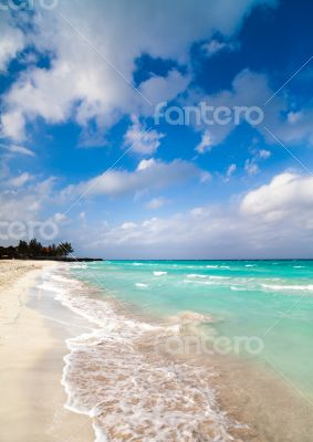 Caribbean Cuba beach with blue sky and clouds