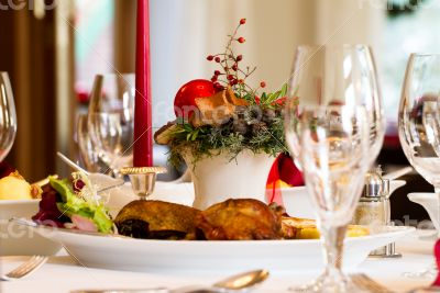 Festive place-setting with Christmas Goose