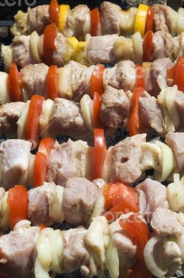 Raw shashlik on a skewer