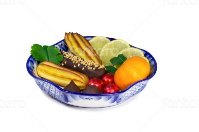 Cakes, sweets, fruit in a vase, painted in the style of the `Gzh