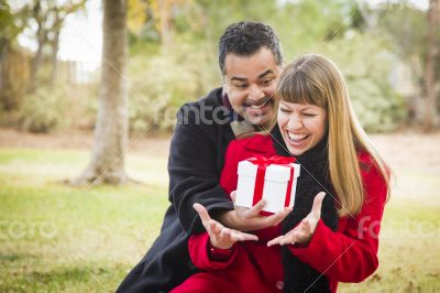 Mixed Race Couple Sharing Christmas or Valentines Day Gift Outsi