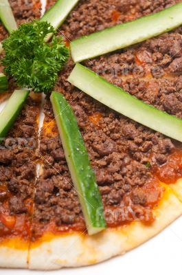 Turkish beef pizza with cucumber on top