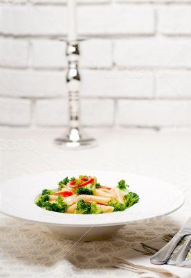 Italian penne pasta with broccoli and chili pepper