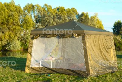 A big tourist tent on the Bank of the river.