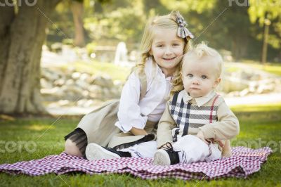 Sweet Little Girl with Her Baby Brother at the Park
