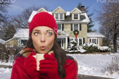 Woman in Winter Clothing Holding Mug Outside in Snow