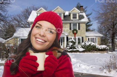 Smiling Woman in Winter Clothing Holding Mug Outside in Snow
