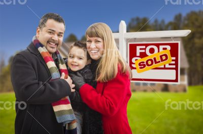 Family in Front of Sold Real Estate Sign and House