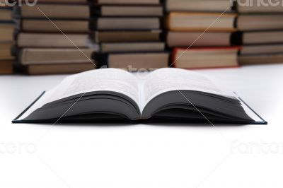 open book on with pile of books