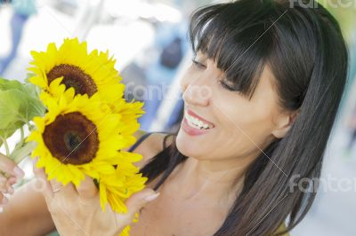 Pretty Italian Woman Looking at Sunflowers at Market