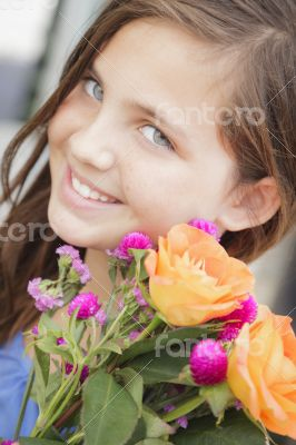 Pretty Young Girl Holding Flower Bouquet at the Market