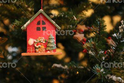 Bear Santa Claus is decorating the Christmas Tree