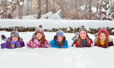 children on snow in winter time