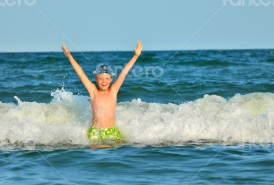 Young boy enjoying the sea