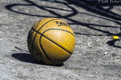 basketball lies in the yard