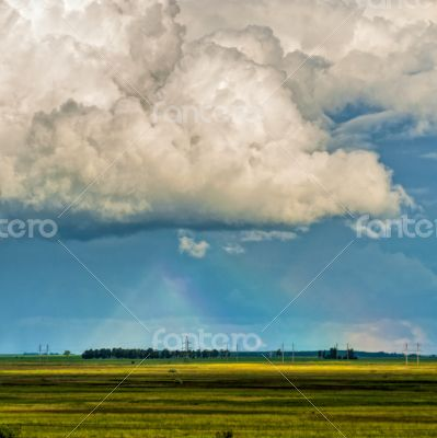 rainbow in the sky over a field