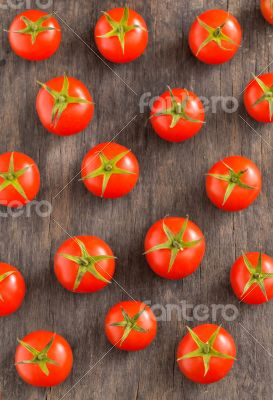 cherry tomatoes on vintage wooden table