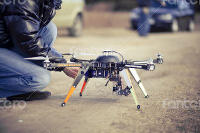 Quadrocopter drone ready to takeoff